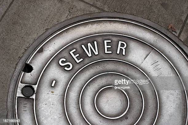 sewer manhole cover - sewer stock pictures, royalty-free photos & images