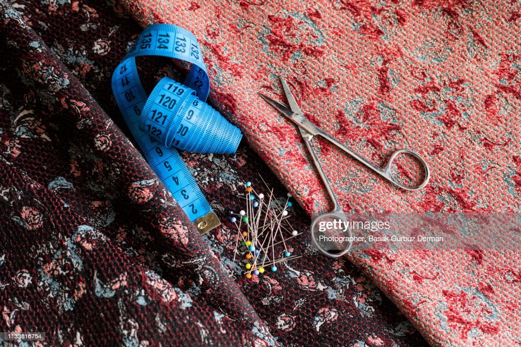 Sewing items; fabric, tape measure, ball head sewing needles, and scissors. : Stock Photo
