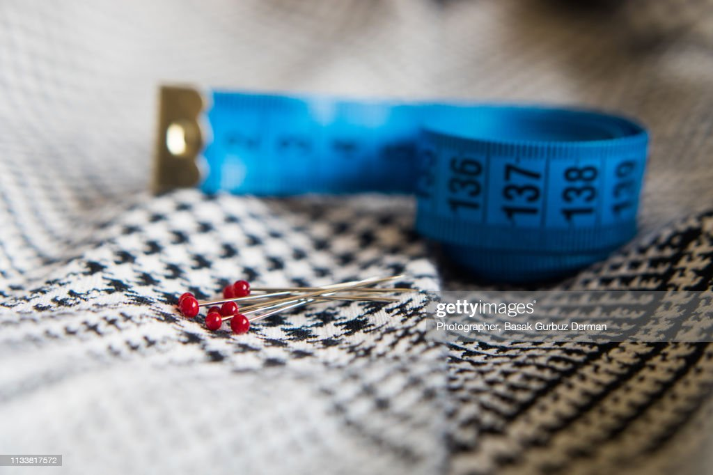 Sewing items; fabric, tape measure, ball head sewing needles. : Stock Photo