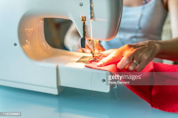 sewing machine. close-up. how to sew a tablecloth - sewing stock pictures, royalty-free photos & images