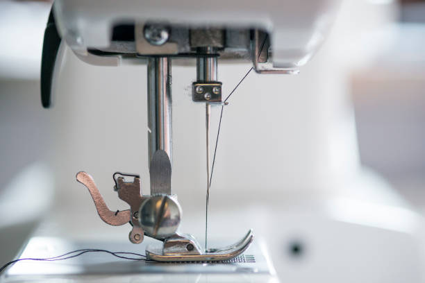 sewing machine mechanism with thread passing through needle picture
