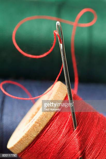 Sewing Needle and Red Thread