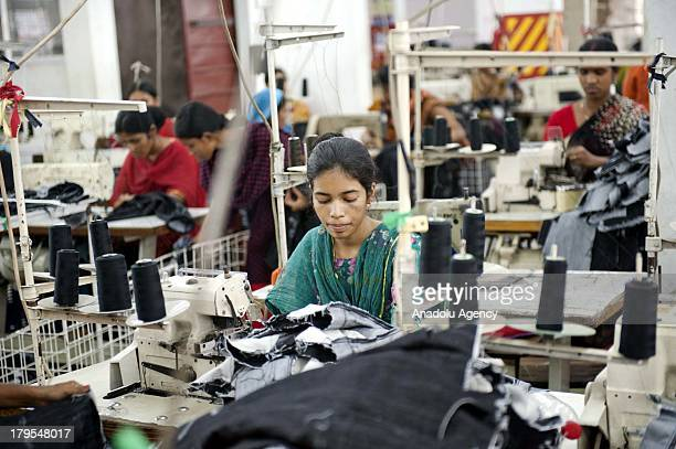 Sewing operator Ferdousy is working in a factory on May 20 2013 in Chittagong Bangladesh Bangladeshi garment workers labor in poor safety...