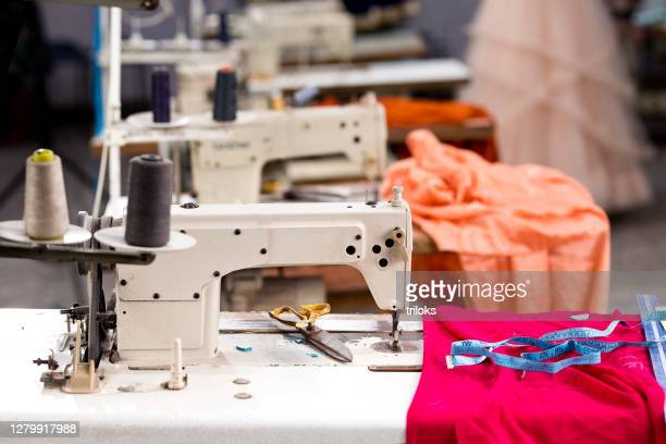 sewing or tailoring industrial hall with machinery - garment stock pictures, royalty-free photos & images