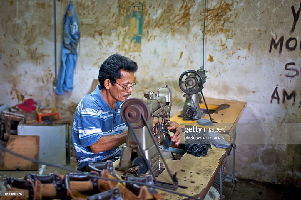 Sewing shoes : Stock Photo
