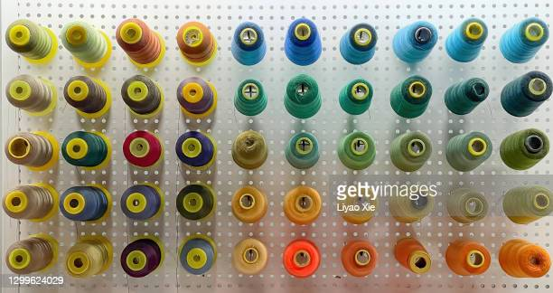 sewing spools - liyao xie stock pictures, royalty-free photos & images