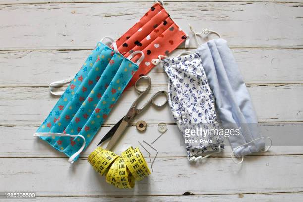 sewing tools and home made face masks on wooden background - ribbon sewing item stock pictures, royalty-free photos & images