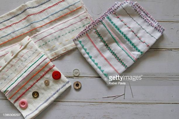 sewing tools on wooden background - ribbon sewing item stock pictures, royalty-free photos & images