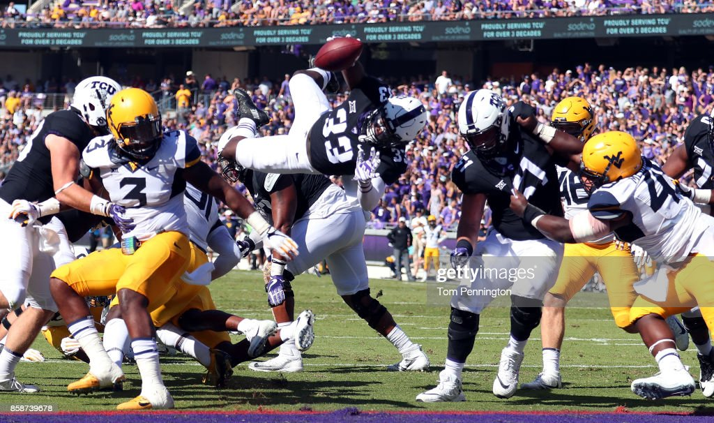 Sewo Olonilua #33 of the TCU Horned Frogs dives into the end zone to score a touchdown against the West Virginia Mountaineers in the first half at Amon G. Carter Stadium on October 7, 2017 in Fort Worth, Texas.
