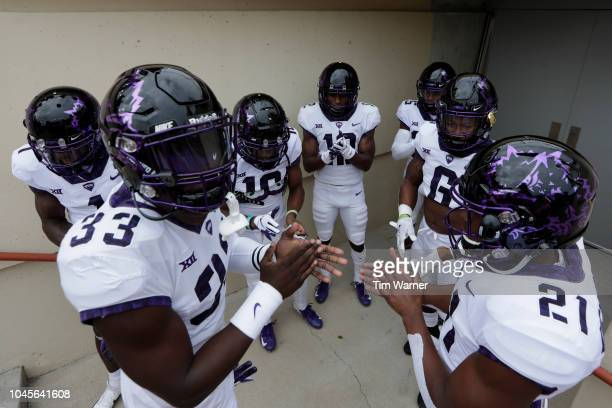 Sewo Olonilua of the TCU Horned Frogs leads the offense onto the field before the game against the Texas Longhorns at Darrell K RoyalTexas Memorial...
