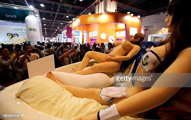 Sex dolls are on display at the Guangzhou Sex Culture Festival in Guangzhou south China's Guangdong province on November 10 2013 The annual sex...
