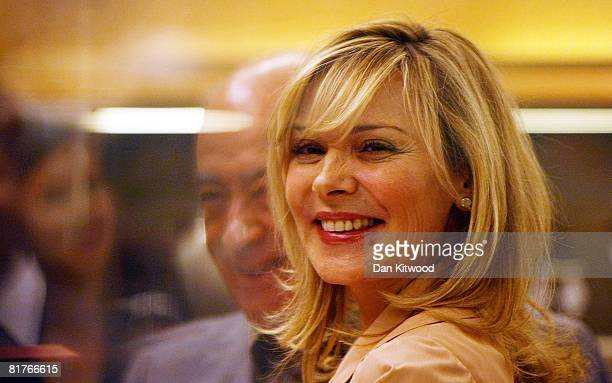 Sex In The City star Kim Cattrall opens the Harrods Summer sale with Mohamed Al Fayed at Harrods department store on June 30 2008 in London England