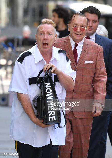 Sex Pistols frontman John Lydon, also known as Johnny Rotten arrives at the Rolls building in central London on July 22, 2021. - Lydon is in court to...