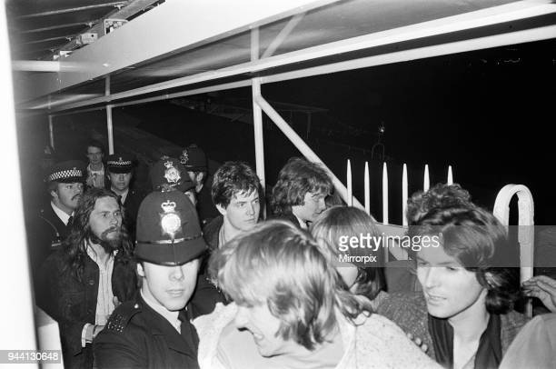 Sex Pistols Jubilee boat party on the Thames. Pictured, guests as they are taken away by police, 7th June 1977.