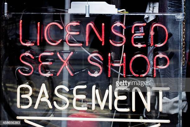 Sex shop in basement - sign