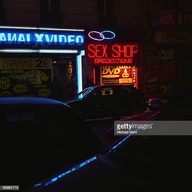Sex shop sign at night.