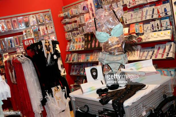Sex toys and teasing lingerie is featured at a shop of Beate Uhse in Flensburg, Germany, 23 July 2013. The Beate Uhse company holds its general...