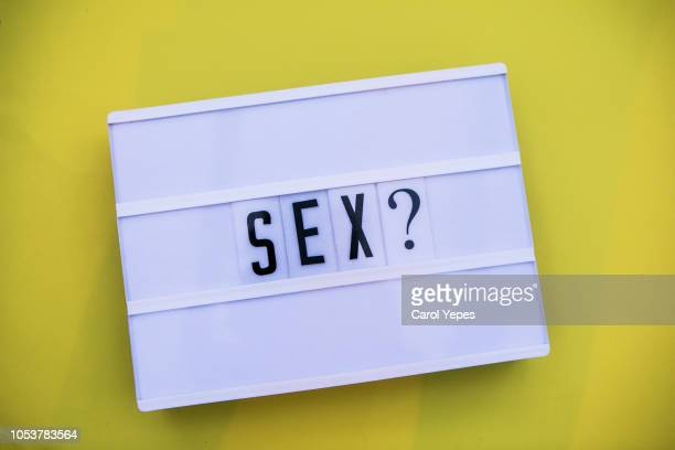 sex word  written in lightbox yellow background - sex stock photos and pictures