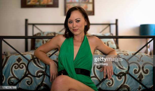 Sex worker Brooke Taylor sits for a photograph inside her room at the Moonlite Bunny Ranch in Mound House Nevada US on Tuesday Aug 20 2013 Growing...
