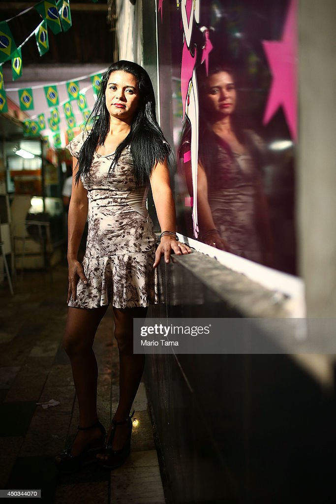 Sex worker Claudia poses in the Vila Mimosa prostitution zone, Rio's working-class red light district, on June 6, 2014 in Rio de Janeiro, Brazil. Claudia said she has worked as a prostitute since the age of 12. Prostitution is legal in Brazil and a total of 3.7 million tourists are expected to be in the country for World Cup festivities.