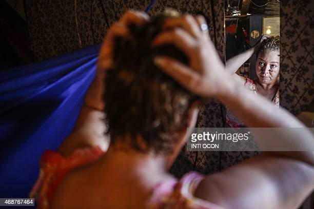 Sex worker Concepcion de Maria Jarquin fixes her her at her home in Sor Maria neighbourhood in the city of Matagalpa 125 km from Managua on March 27...