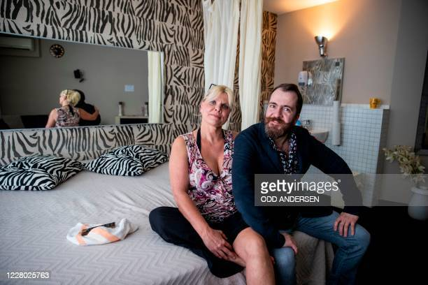 Sex worker Jana and manager Aurel Johannes Marx pose for a picture in a room at the Candy Store brothel in Berlin on August 10 2020 amid the Covid19...