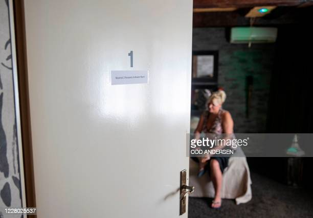 Sex worker Jana sits on a bed during an interview with AFP at the Candy Store brothel in Berlin on August 10 2020 amid the Covid19 corona virus...