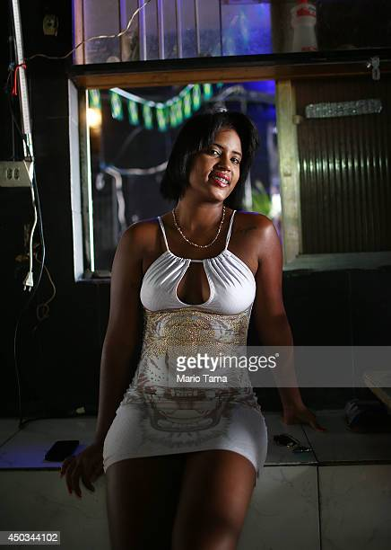 A sex worker poses in the Vila Mimosa prostitution zone Rio's workingclass red light district on June 5 2014 in Rio de Janeiro Brazil Prostitution is...