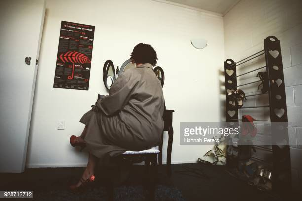 A sex worker puts on makeup in the communal dressing room where various changes of clothes lingerie and shoes are provided ahead of a booking at The...