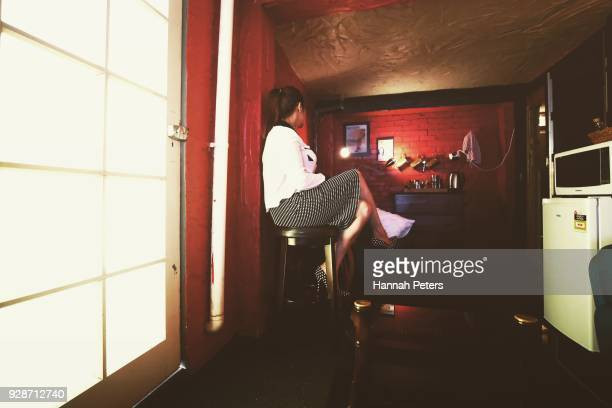 A sex worker relaxes in the communal lounge ahead of her next booking at The Bach an ethical escort service on October 19 2017 in Whangarei New...