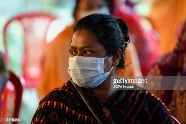 Sex worker seen waiting to get inoculated with the Sinopharm vaccine against the Covid-19 coronavirus during a special vaccination drive at Daulatdia...