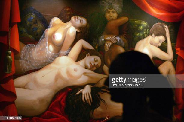 A sex worker speaks to a journalist as she sits in a suite of Berlin's Artemis brothel 04 May 2006 Artemis the largest brothel in Berlin boasts 4...