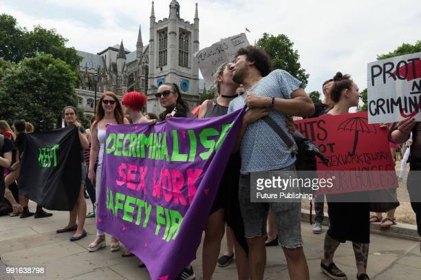 Sex workers and activists stage a protest outside Parliament in London as MPs debate a proposal to outlaw online prostitution platforms The members...