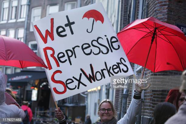 Sex workers and supporters take part during march protest against the new Dutch sex work law in the Red Light District on October 31 2019 in...