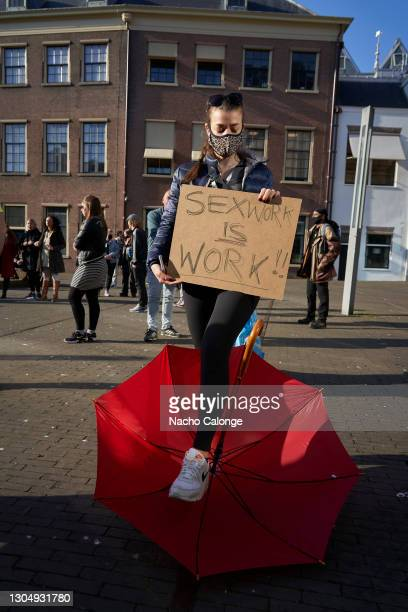 Sex workers display placards demanding their rights during a demonstration on March 2, 2021 in The Hague, Netherlands. The Dutch government has eased...
