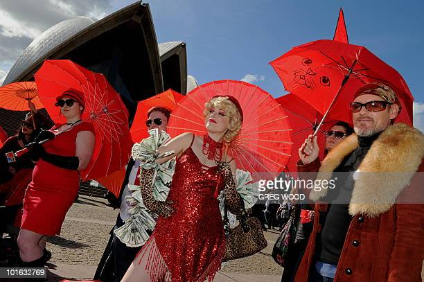 Sex workers including 'Ginger Snap' and their supporters rally on the steps of the Sydney Opera House to demand legislative antidiscrimination...