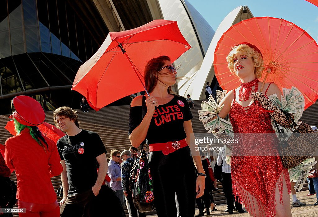 Sex workers including 'Ginger Snap' (R) and their supporters rally on the steps of the Sydney Opera House to demand legislative anti-discrimination protection for sex workers in Sydney on June 5, 2010. The rally is part of a week of events around International Whores Day, which commemorates the day on June 2, 1975 when a church in Lyon, France, was taken over by sex workers complaining about the lack of action by police when sex workers reported a crime. AFP PHOTO/Greg WOOD