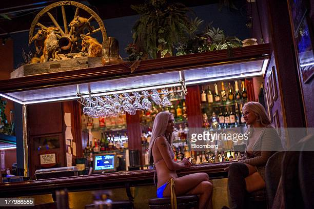 Sex workers Jaylynn Jones left and Sarah Vandella who also works as an adult film actress sit at the bar at the Mustang Ranch brothel in Sparks...