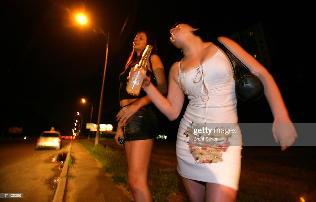 Sex workers on the ring road surrounding Kiev wait for roadside clients on August 12, 2005 in Kiev, Ukraine. These girls are the cheapest and most at risk. There are some initiatives funded by the Global Fund for Condom distribution and needle exchange for drug users.The Sex workers are difficult to communicate with as there is great fear of the police. Getty Images is partnering with the Global Business Coalition on HIV/AIDS ongoing projects.