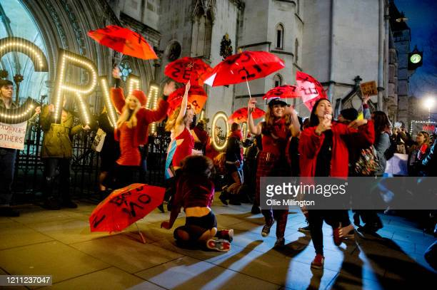 Sex workers perform a dance routine while joined by members of the public attending a decriminalisatioin Rally at The Royal Courts of Justice after...