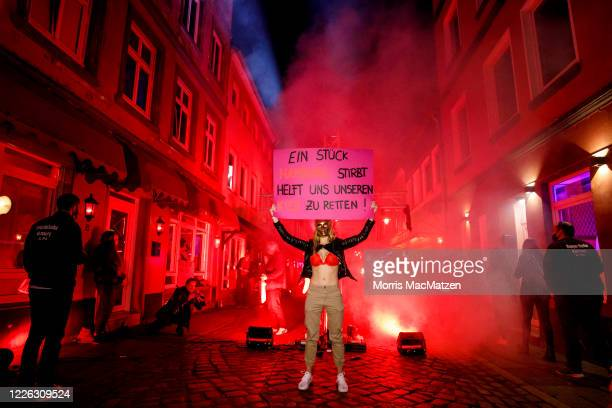 Sex workers protest against lockdown measures that are preventing brothels from reopening in Hamburg's red light district during the coronavirus...