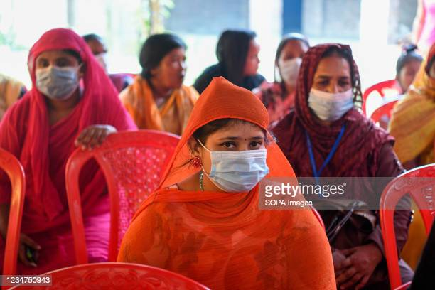 Sex workers seen waiting to get inoculated with the Sinopharm vaccine against the Covid-19 coronavirus during a special vaccination drive at...