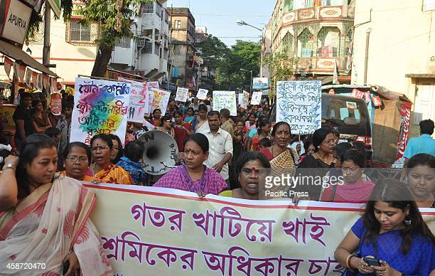 Sex workers take part in a rally to demand their rights as workers in Kolkata