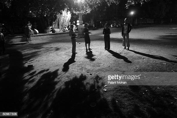 Sex workers wait for business in one of the many parks in the early hours in the morning May 20, 2004 in Phnom Penh, Cambodia. A million people in...