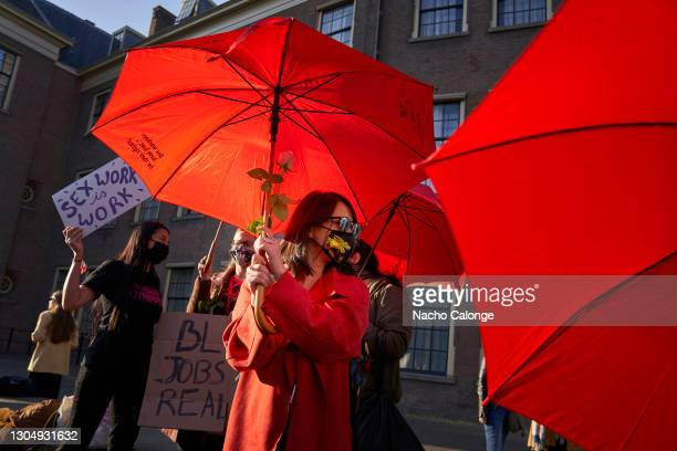 Sex workers with red umbrellas, the symbol of the Proud organisation, during the demonstration on March 2, 2021 in The Hague, Netherlands. The Dutch...