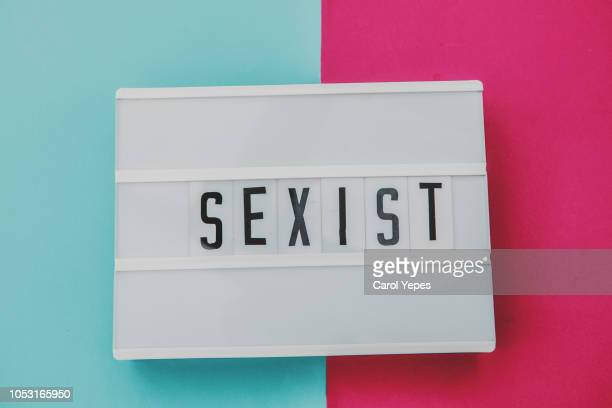 sexist word - geschlechtsdiskriminierung stock-fotos und bilder