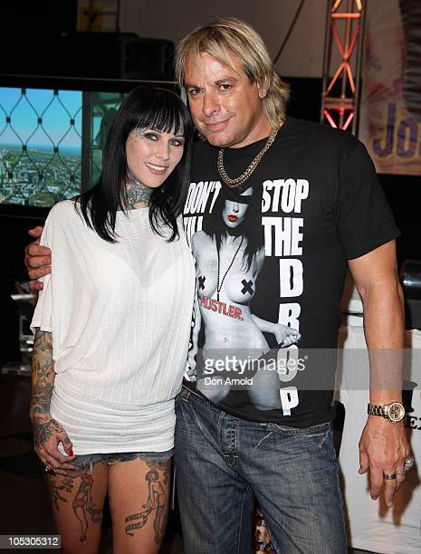 Sexpo performer Michelle Bombshell McGee poses alongside Warwick Capper at Sexpo 2010 at Hordern Pavilion on October 14, 2010 in Sydney, Australia.