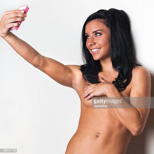 Sexting; Young Woman Sending Nude Pictures of Herself With Phone