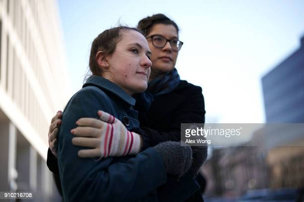 Sexual assault victim Madelynn Wellons is comforted by a friend after she spoke during a news conference on a Title IX lawsuit outside Department of...
