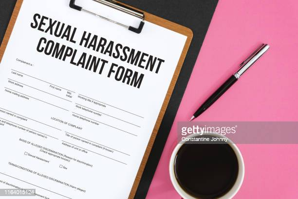 sexual harassment complaint form on clipboard - social issues stock pictures, royalty-free photos & images